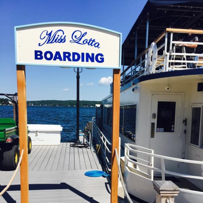 The Miss Lotta Boarding sign next to the boat