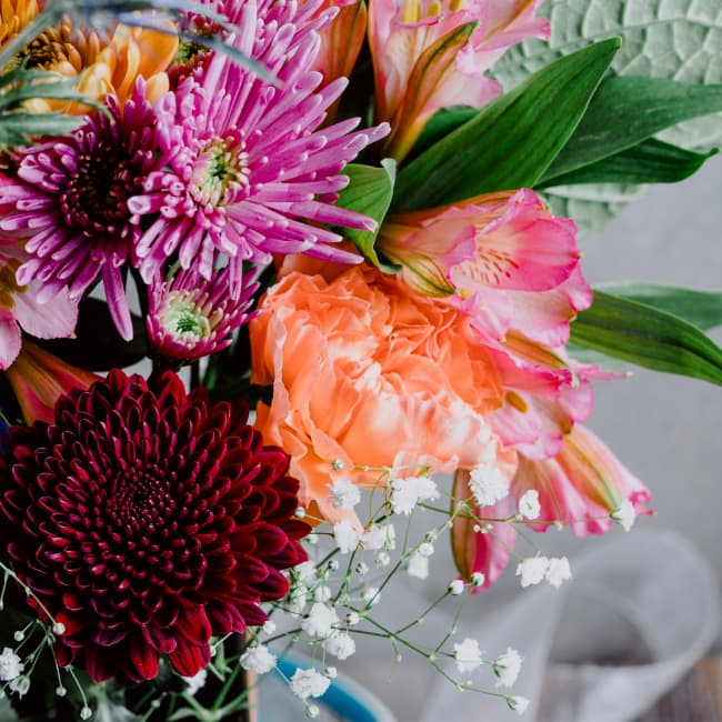 A vase of colorful assorted flowers