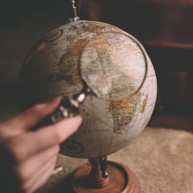 A magnifying glass on a globe