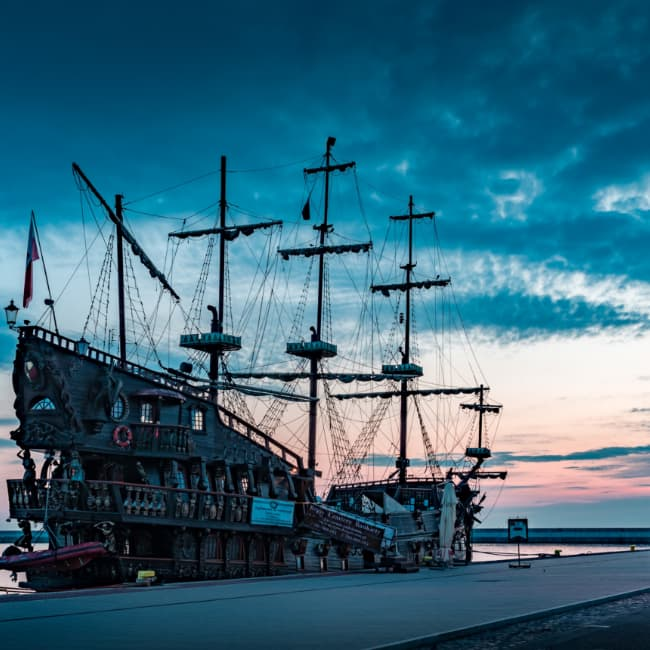 A pirate ship at a dock