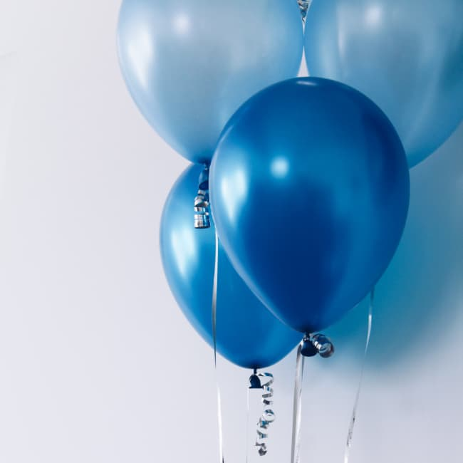 blue balloons against a white wall